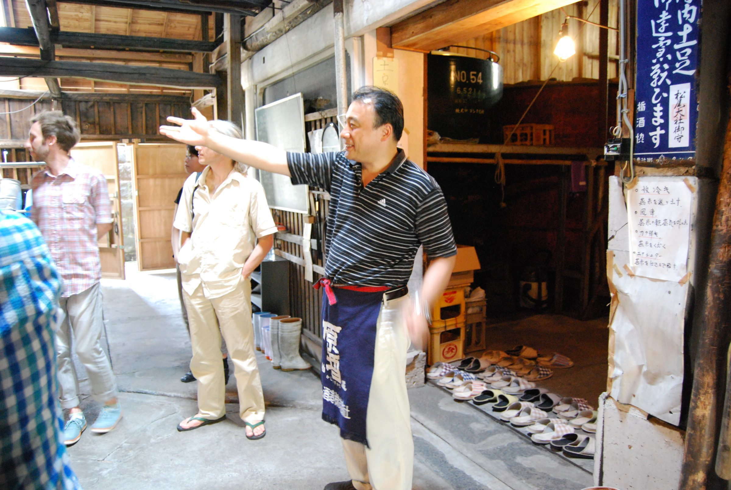 Katayama-san showing me and a few other visitors around his brewery