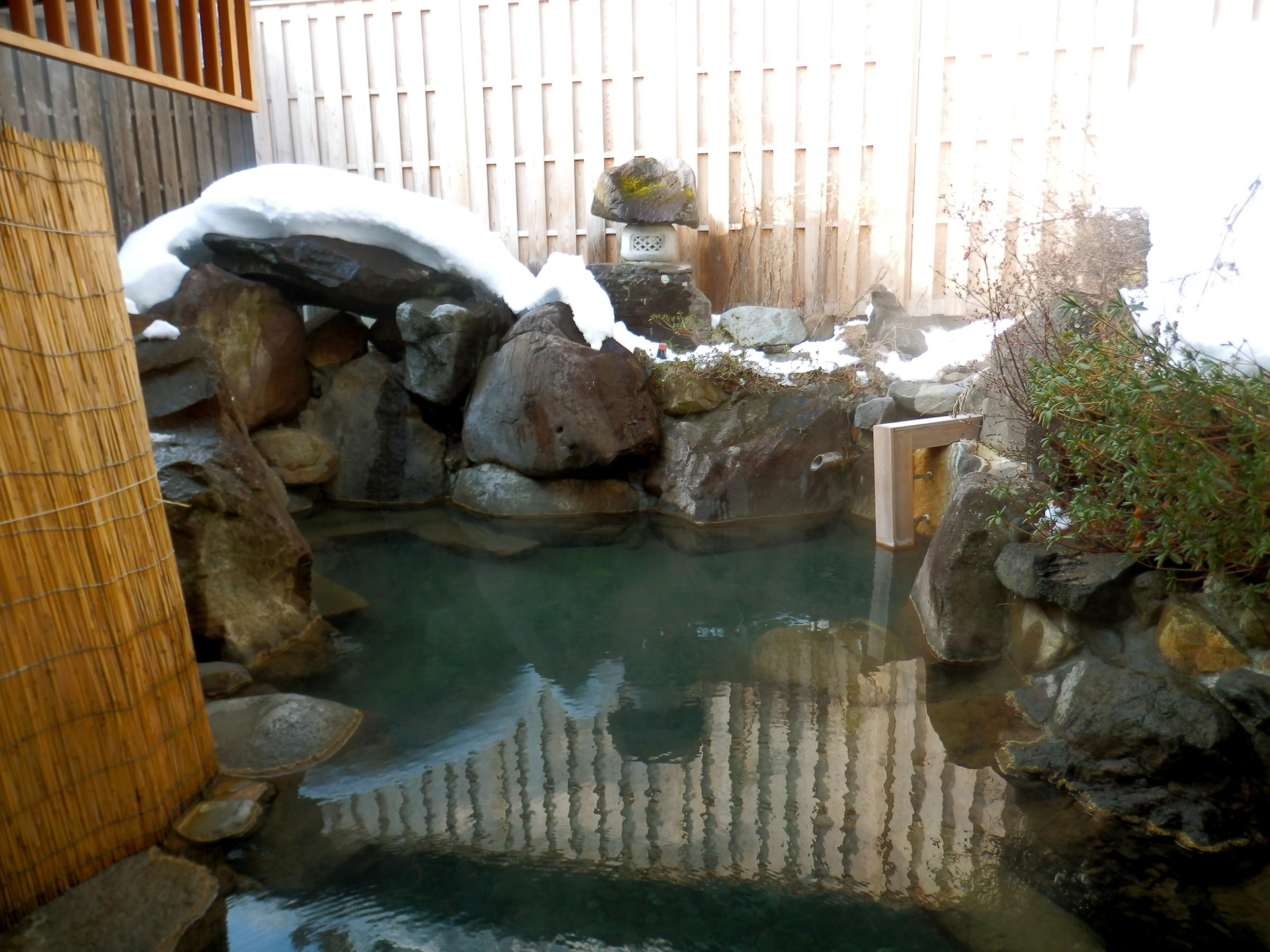 The onsen hot spring bath at Jinpyokaku ryokan in Yudanaka.