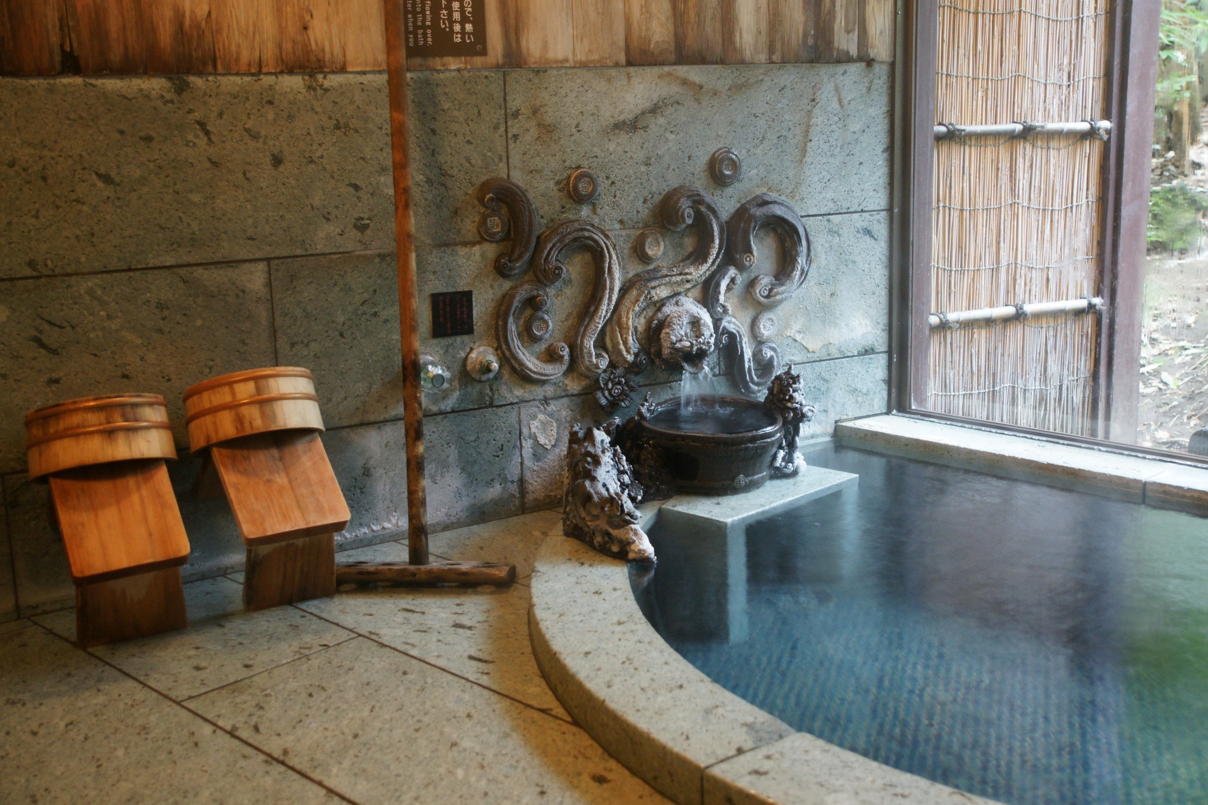 Ornate hot spring baths at the Hanafubuki