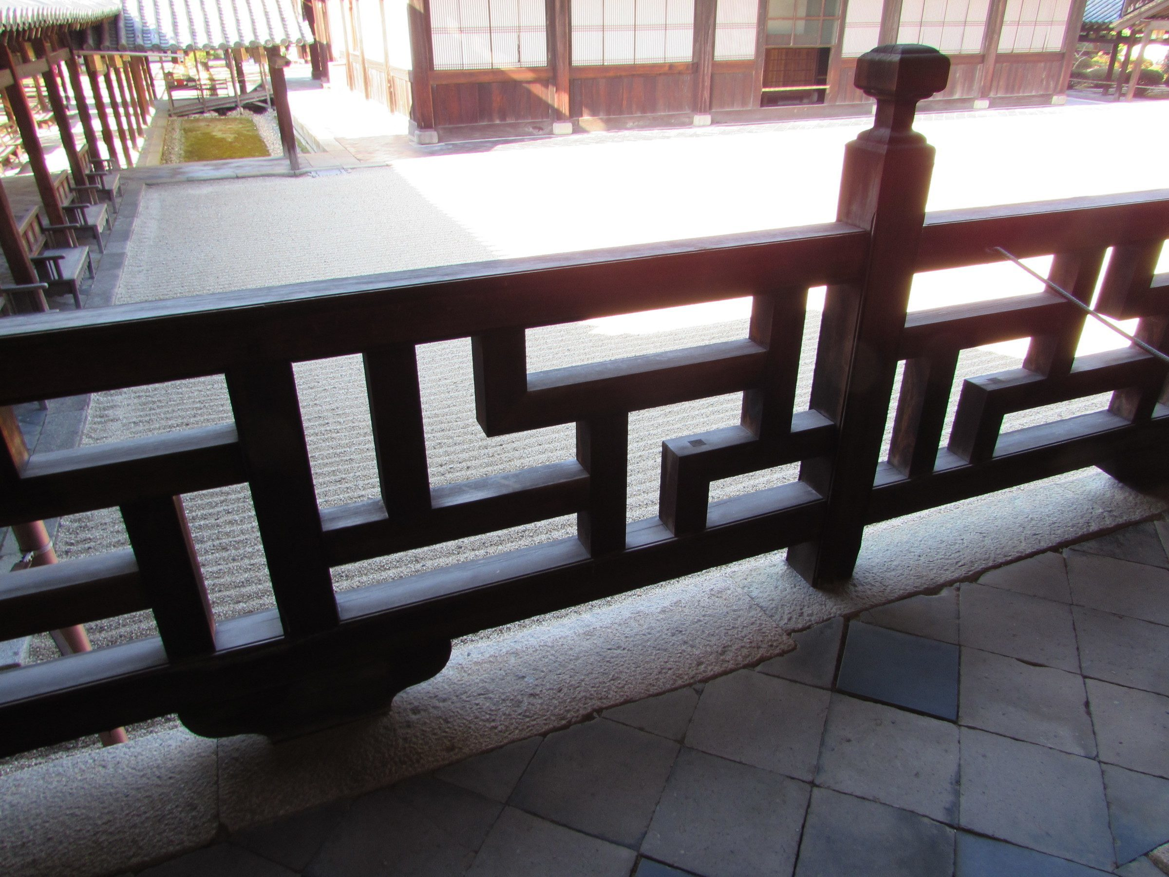 One final thing that Mampuku-ji is famous for are the fences that surround the buildings, which are based on swastika designs. Although the swastika now has sinister associations in the west following it's appropriation by the Nazi party, it has a history going back thousands of years in Asia. It began as a sacred Hindu symbol of auspiciousness that was later adopted by Buddhism. Although it's a little tricky to make out the swastika pattern in this fence...