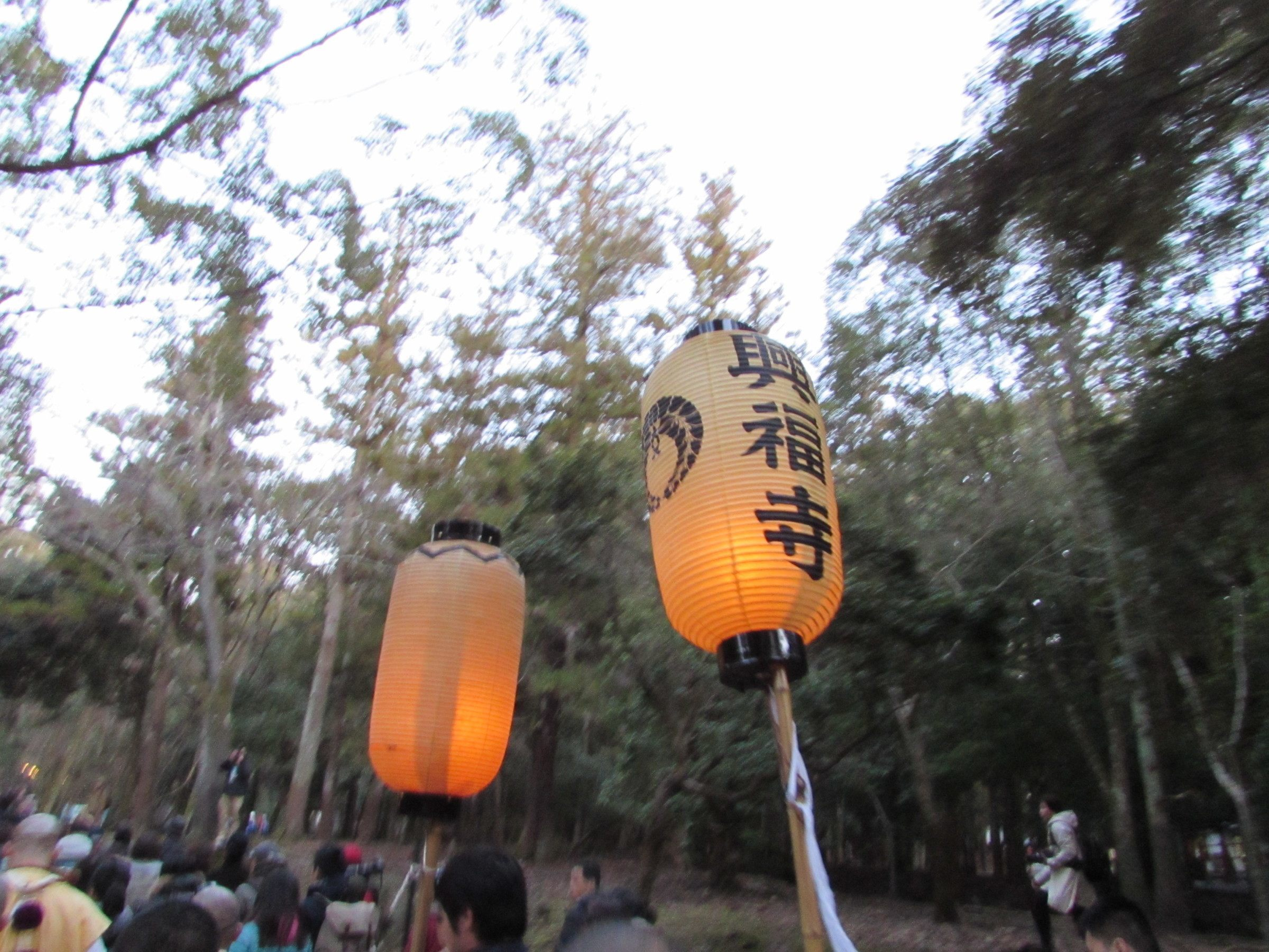 ... and from the torch three lanterns are lit. There is one lantern representing each of Nara's main religious sites; Todai-ji temple, Kofuku-ji temple, and Kasuga shrine. The lanterns are then paraded through the city towards the Mt. Wakakusa.