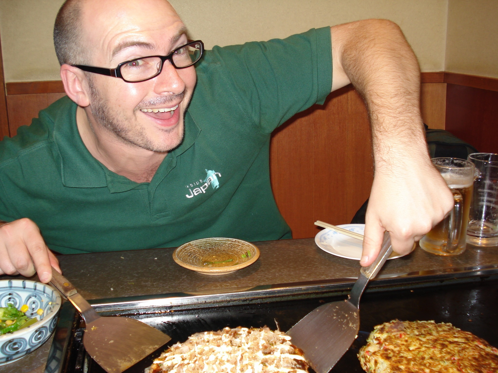 Alastair making okonomiyaki, and looking pretty happy about it too
