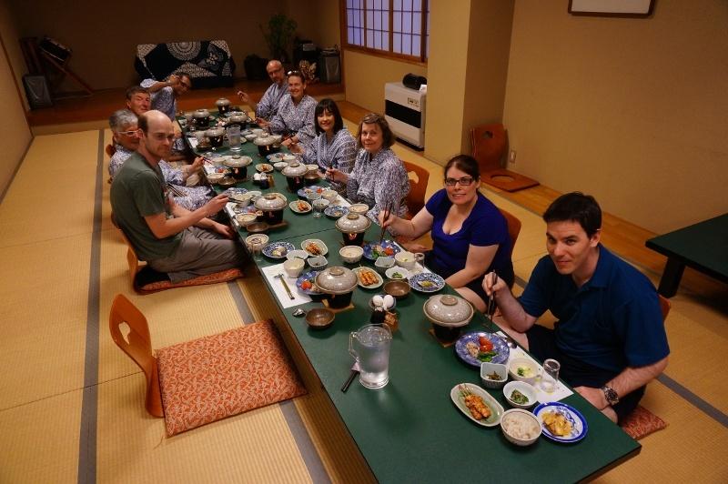 An IJT tour group enjoying kaiseki cuisine at a tradional inn