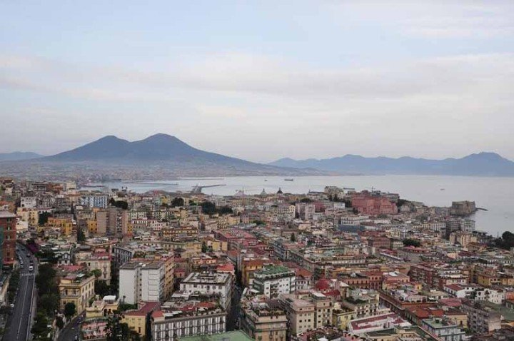 The city of Naples in Italy, with Mount Vesuvius in the background