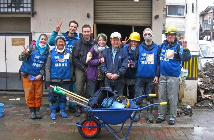 Former team member Ester De Roij volunteering with It's Not Just Mud