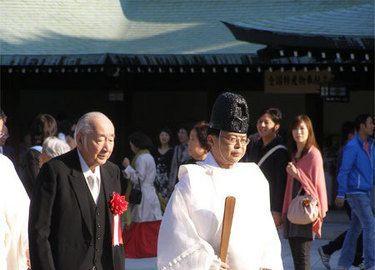 Shinto priest leading a procession in Tokyo